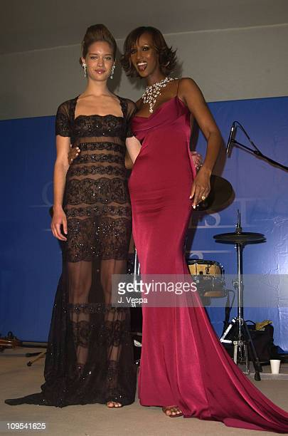Julie Ordon and Iman both wearing DeBeers jewelry during 2003 Cannes Film Festival Cinema Against Aids 2003 to benefit amfAR sponsored by Miramax...