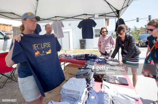 Julie Patnode sells eclipsethemed tshirts to tourists on August 20 2017 in Driggs Idaho The small town expected an influx of more tourists than those...