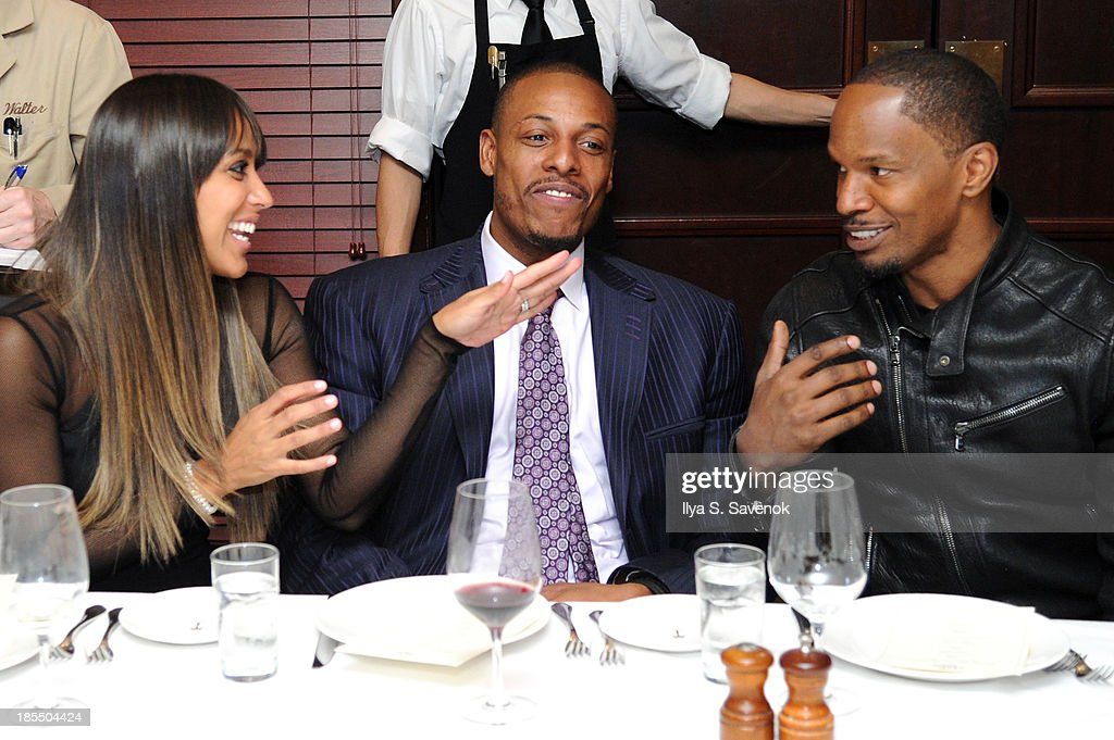 Julie Pierce, NBA player Paul Pierce, and actor/singer Jamie Foxx attend DuJour Magazine's Jason Binn Along With GRAFF's Henri Barguirdjian's Dinner Party Welcoming Brooklyn Nets Paul Pierce To New York at The Palm Tribeca on October 21, 2013 in New York City.