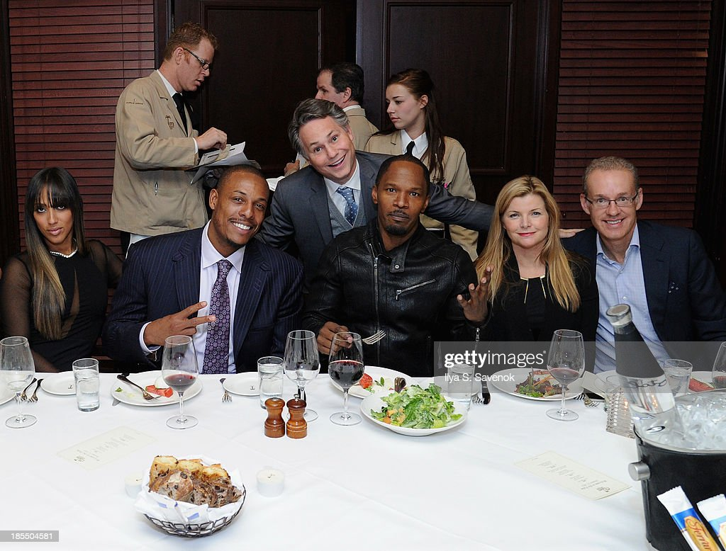 Julie Pierce, NBA player Paul Pierce, Jason Binn, actor/singer Jamie Foxx, Emily Smith, and Kevin P. Ryan Chairman & Founder of Gilt, MongoDB, Business Insider & Zola attend DuJour Magazine's Jason Binn Along With GRAFF's Henri Barguirdjian's Dinner Party Welcoming Brooklyn Nets Paul Pierce To New York at The Palm Tribeca on October 21, 2013 in New York City.