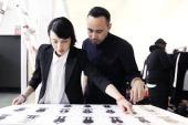 Julie Ragolia and Carlos Campos prep before the Carlos Campos Presentation during MercedesBenz Fashion Week Fall 2014 at Industria Studios on...