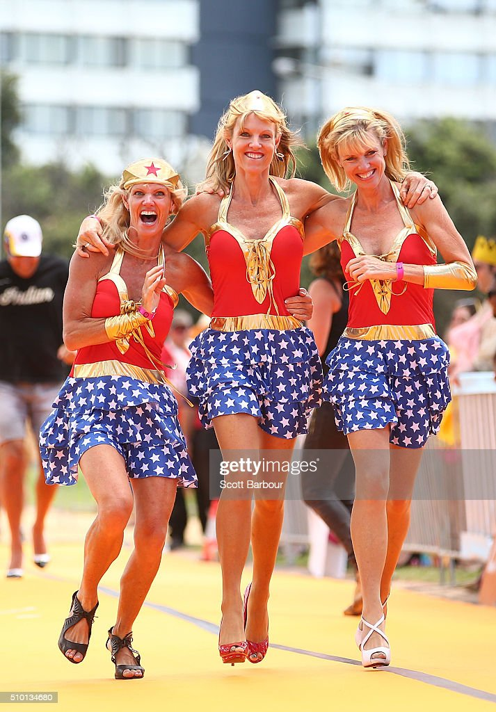 Julie Richardson, Sharon Richardson and Michelle Sorensen who are triplets run while wearing high heeled shoes as they take part in a Guinness World Record attempt for the largest amount of people running in high heels on February 14, 2016 in Melbourne, Australia. The World's Largest High Heel Race 2016 raised funds for the The Warwick Cancer Foundation. The current record is 967 people, completed in Indiana, USA in 2010.