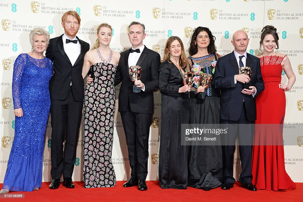 Julie Walters, Domhnall Gleeson, Saoirse Ronan, John Crowley, Finola Dwyer, Amanda Posey, Nick Hornby and guest pose with the Outstanding British Film award for 'Brooklyn' in the winners room at the EE British Academy Film Awards at The Royal Opera House on February 14, 2016 in London, England.
