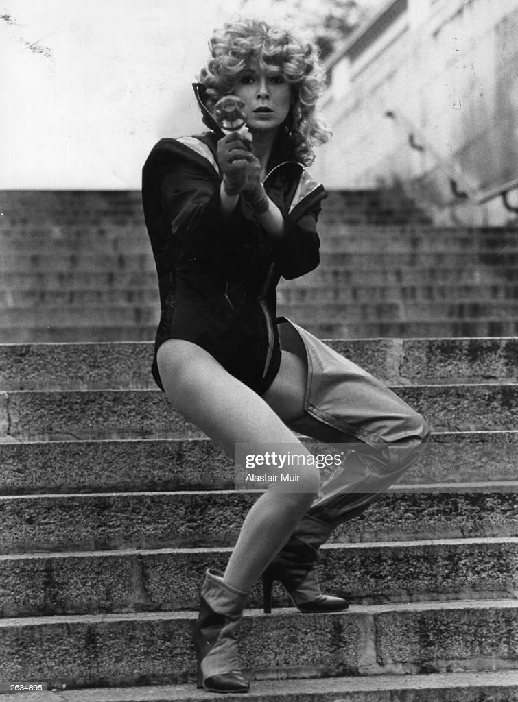 Julie Walters, the actress, pictured blasting her way into the new play 'Flaming Bodies' which is being put on by the ICA Theatre. She is playing the part of a stunt girl. Original Publication: People Disc - HM0252