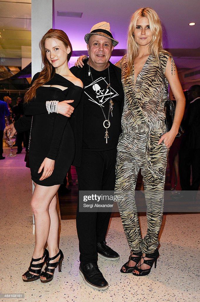Julie Wynn, Edward Bass & Taylor McClur attend Niche Media Party Hosted By Zoe Saldana on December 6, 2013 in Miami Beach, Florida.