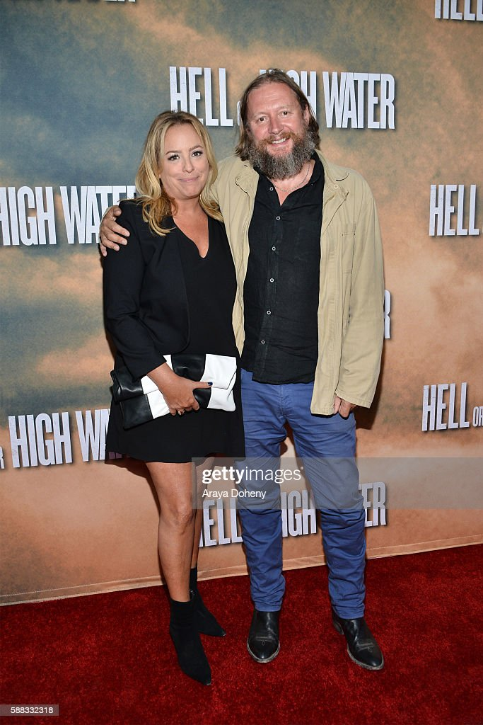Julie Yorn and David Mackenzie arrive at the screening of CBS Films' 'Hell Or High Water' at ArcLight Hollywood on August 10 2016 in Hollywood...