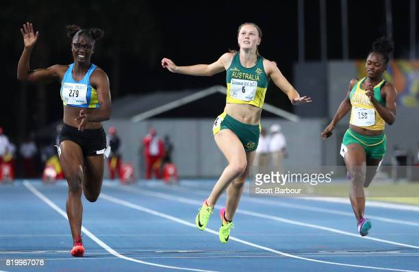 Julien Alfred of Saint Lucia crosses the finish line to win the Girls 1500m Final ahead of Riley Day of Australia during the Athletics on day 3 of...