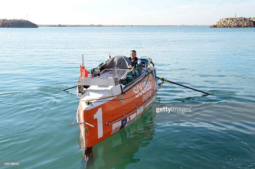 Julien Bahain, French Olympic rower, sits in a rowing boat before his attempt along with Patrick Favre at an Atlantic crossing on January 8, 2013, in Tarfaya, southern Morocco.