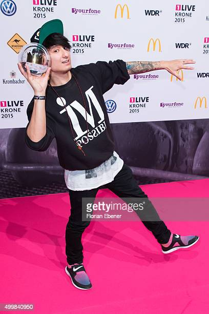 Julien Bam presents his award during the 1Live Krone 2015 at Jahrhunderthalle on December 3 2015 in Bochum Germany