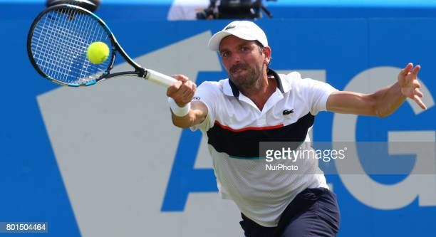 Julien Benneteau against Grigor Dimitrov BUL against during Round Two match on the third day of the ATP Aegon Championships at the Queen's Club in...