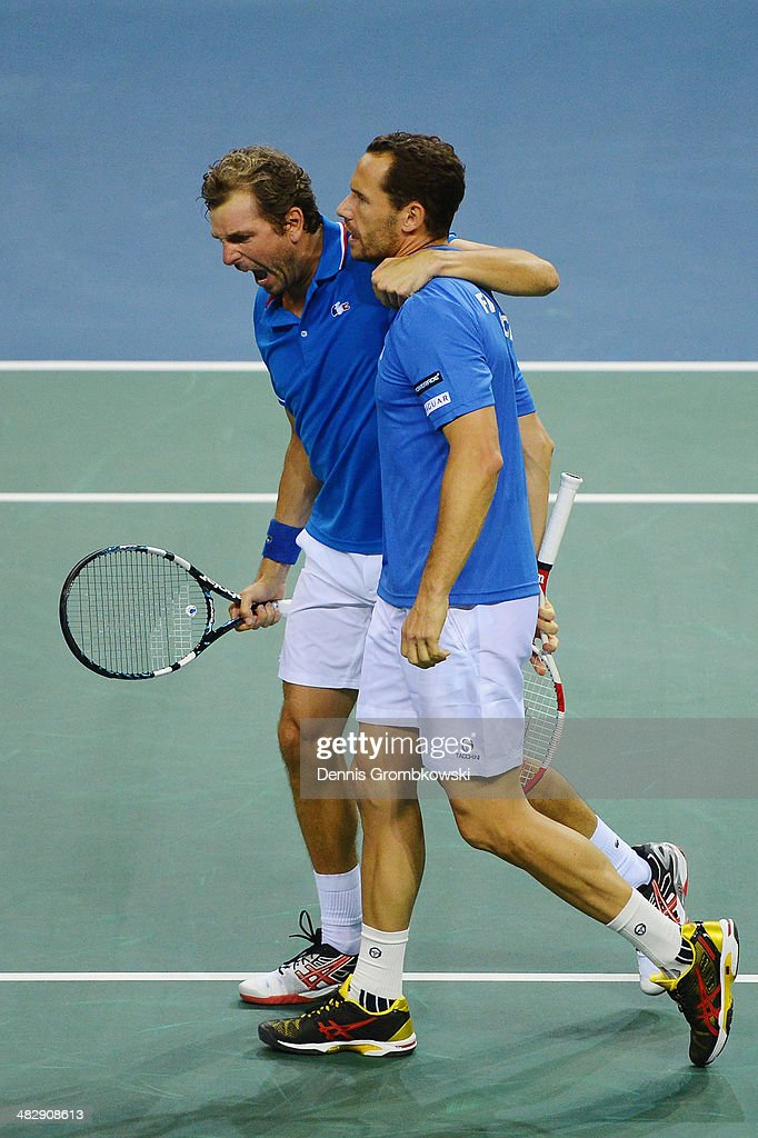 <a gi-track='captionPersonalityLinkClicked' href=/galleries/search?phrase=Julien+Benneteau&family=editorial&specificpeople=228097 ng-click='$event.stopPropagation()'>Julien Benneteau</a> and <a gi-track='captionPersonalityLinkClicked' href=/galleries/search?phrase=Michael+Llodra&family=editorial&specificpeople=208919 ng-click='$event.stopPropagation()'>Michael Llodra</a> of France celebrate after winning their double match against Tobias Kamke and Andre Begemann of Germany during day 2 of the Davis Cup Quarter Final match between France and Germany on April 5, 2014 in Nancy, France.