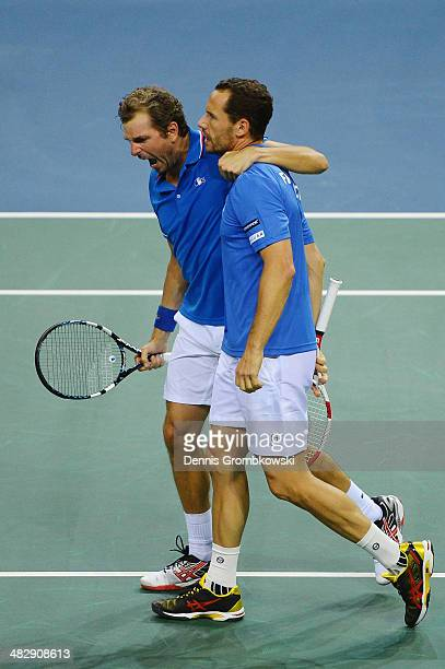 Julien Benneteau and Michael Llodra of France celebrate after winning their double match against Tobias Kamke and Andre Begemann of Germany during...