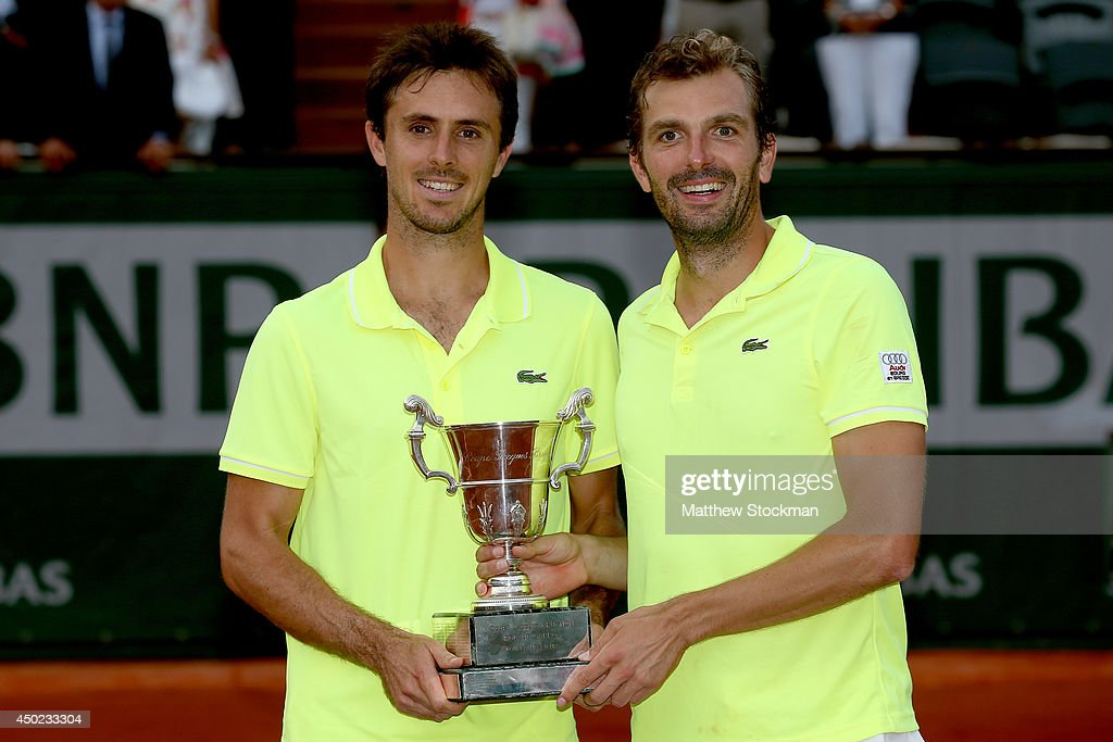 <a gi-track='captionPersonalityLinkClicked' href=/galleries/search?phrase=Julien+Benneteau&family=editorial&specificpeople=228097 ng-click='$event.stopPropagation()'>Julien Benneteau</a> (R) of France and <a gi-track='captionPersonalityLinkClicked' href=/galleries/search?phrase=Edouard+Roger-Vasselin&family=editorial&specificpeople=4312893 ng-click='$event.stopPropagation()'>Edouard Roger-Vasselin</a> of France pose with the trophy following their victory in their men's doubles final match against Marcel Granollers of Spain and Marc Lopez on day fourteen of the French Open at Roland Garros on June 7, 2014 in Paris, France.