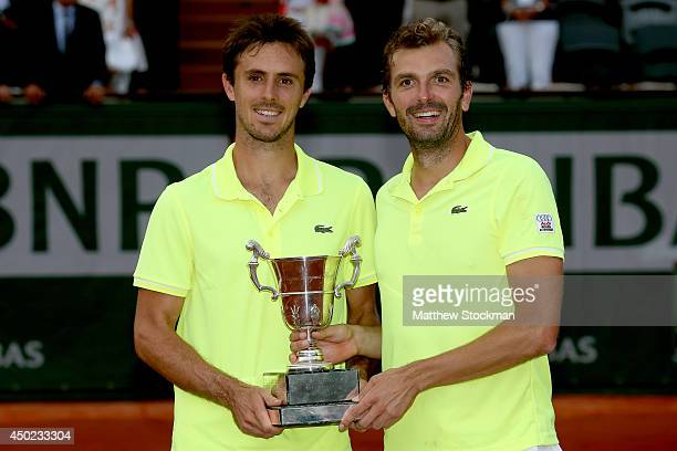 Julien Benneteau of France and Edouard RogerVasselin of France pose with the trophy following their victory in their men's doubles final match...