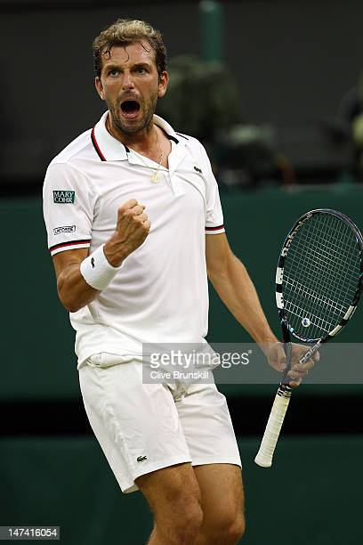 Julien Benneteau of France celebrates set point during his Gentlemen's Singles third round match against Roger Federer of Switzerland on day five of...