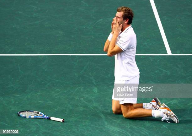 Julien Benneteau of France celebrates winning match point during his match against Roger Federer of Switzerland during the ATP Masters Series at the...