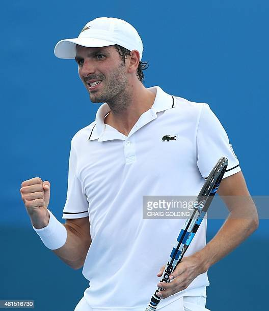 Julien Benneteau of France celebrates winning the set against Vasek Pospisil of Canada during their men's singles match on day four of the Sydney...