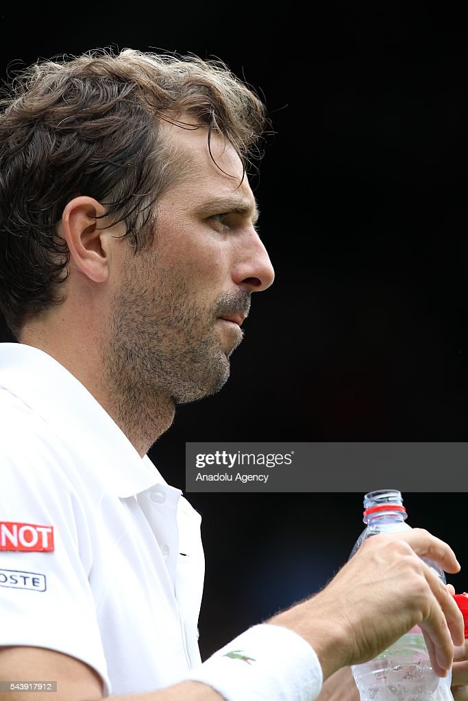 Julien Benneteau of France gestures during the tennis match against Kei NIshikori (not seen) of Japan in the men's singles on day four of the 2016 Wimbledon Championships at the All England Lawn and Croquet Club in London, United Kingdom on June 30, 2016.