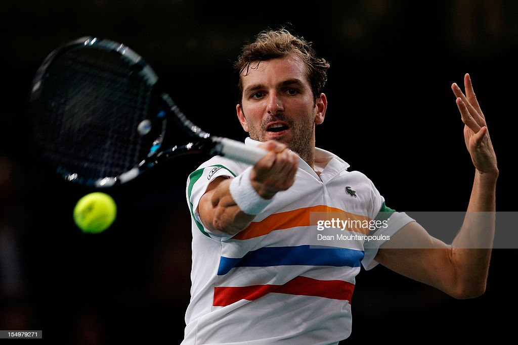 <a gi-track='captionPersonalityLinkClicked' href=/galleries/search?phrase=Julien+Benneteau&family=editorial&specificpeople=228097 ng-click='$event.stopPropagation()'>Julien Benneteau</a> of France in action against Viktor Troicki of Serbia during day 1 of the BNP Paribas Masters at Palais Omnisports de Bercy on October 29, 2012 in Paris, France.