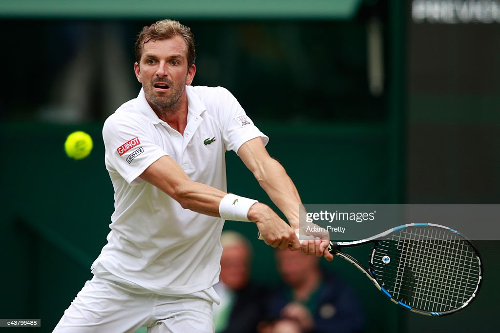 <a gi-track='captionPersonalityLinkClicked' href=/galleries/search?phrase=Julien+Benneteau&family=editorial&specificpeople=228097 ng-click='$event.stopPropagation()'>Julien Benneteau</a> of France plays a backhand during the Men's Singles second round match against Kei Nishikori of Japan on day four of the Wimbledon Lawn Tennis Championships at the All England Lawn Tennis and Croquet Club on June 30, 2016 in London, England.