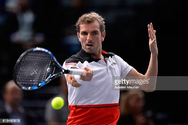 Julien Benneteau of France plays a forehand during his first Men's first round match against Gilles Simon of France on day one of the BNP Paribas...