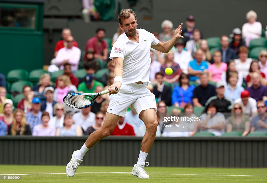 <a gi-track='captionPersonalityLinkClicked' href=/galleries/search?phrase=Julien+Benneteau&family=editorial&specificpeople=228097 ng-click='$event.stopPropagation()'>Julien Benneteau</a> of France plays a forehand during the Men's Singles second round match against Kei Nishikori of Japan on day four of the Wimbledon Lawn Tennis Championships at the All England Lawn Tennis and Croquet Club on June 30, 2016 in London, England.