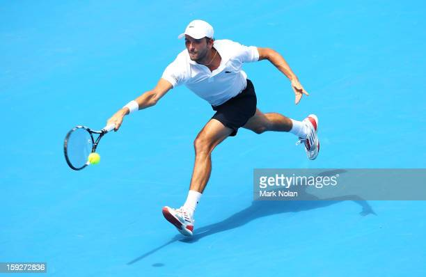 Julien Benneteau of France plays a forehand in his semi final match against Kevin Anderson of South Africa during day six of the Sydney International...