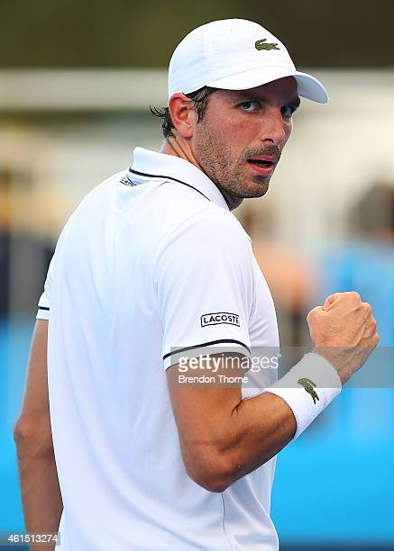 Julien Benneteau of France reacts after winning a point in his second round match against Vasek Pospisil of Canada plays a backhand during day four...