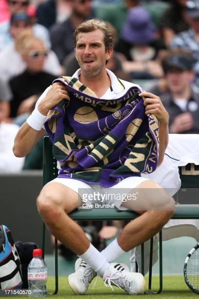 Julien Benneteau of France reacts during a break in his Gentlemen's Singles second round match against Fernando Verdasco of Spain on day three of the...