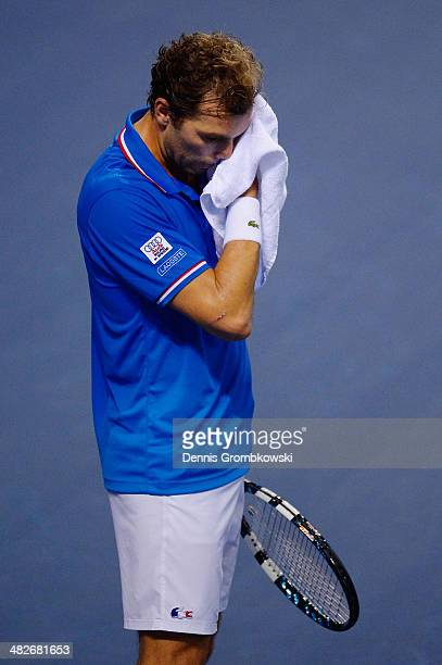 Julien Benneteau of France reacts during his match against Tobias Kamke of Germany during day 1 of the Davis Cup Quarter Final match between France...