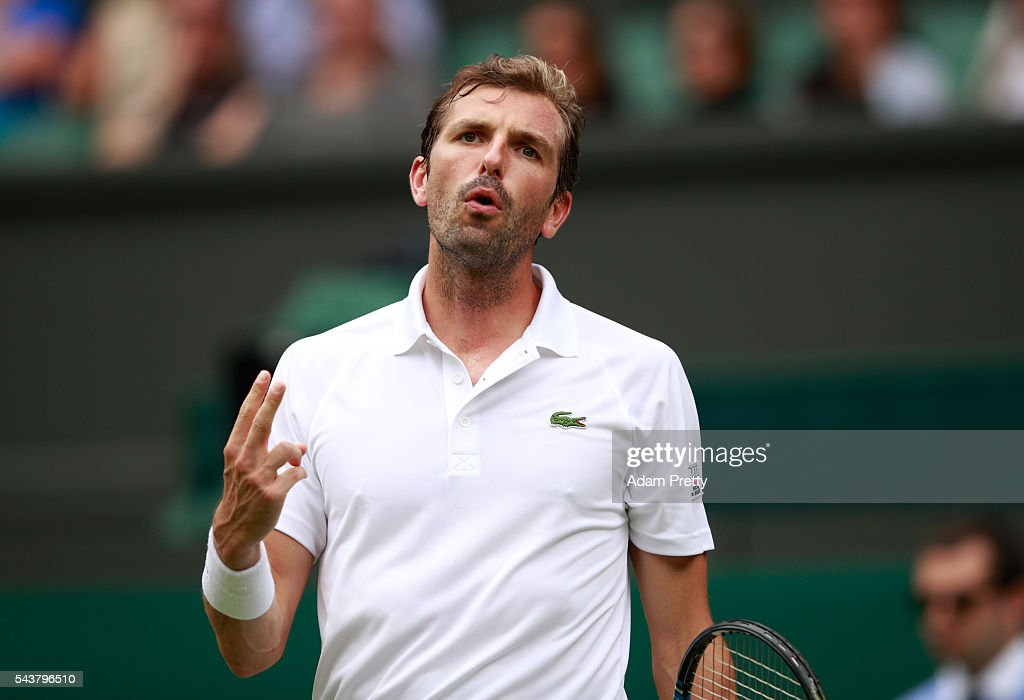 <a gi-track='captionPersonalityLinkClicked' href=/galleries/search?phrase=Julien+Benneteau&family=editorial&specificpeople=228097 ng-click='$event.stopPropagation()'>Julien Benneteau</a> of France reacts during the Men's Singles second round match against Kei Nishikori of Japan on day four of the Wimbledon Lawn Tennis Championships at the All England Lawn Tennis and Croquet Club on June 30, 2016 in London, England.