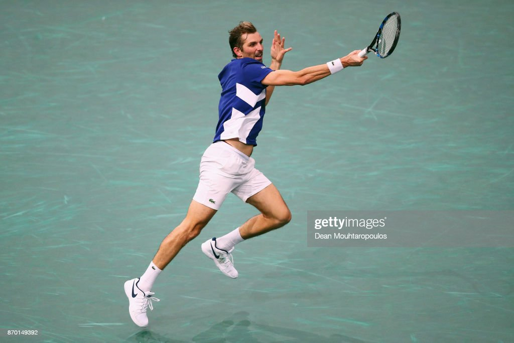 Julien Benneteau of France returns a forehand against Jack Sock of the USA during their semi final on day 6 of the Rolex Paris Masters held at the AccorHotels Arena on November 4, 2017 in Paris, France.