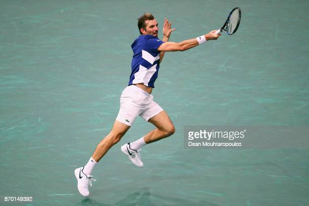 Julien Benneteau of France returns a forehand against Jack Sock of the USA during their semi final on day 6 of the Rolex Paris Masters held at the...