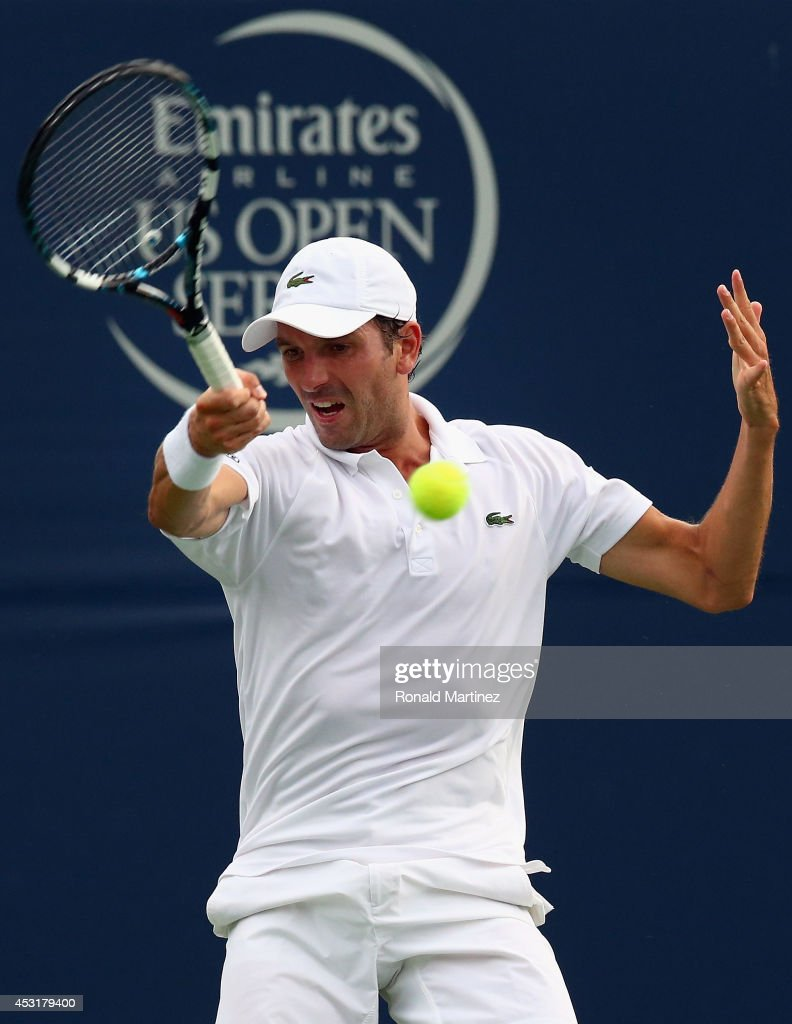 <a gi-track='captionPersonalityLinkClicked' href=/galleries/search?phrase=Julien+Benneteau&family=editorial&specificpeople=228097 ng-click='$event.stopPropagation()'>Julien Benneteau</a> of France returns a shot to Lleyton Hewitt of Australia during Rogers Cup at Rexall Centre at York University on August 4, 2014 in Toronto, Canada.