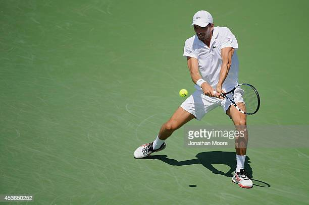 Julien Benneteau of France returns to Stan Wawrinka of Switzerland on day 7 of the Western Southern Open at the Linder Family Center on August 15...