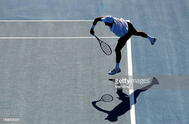 Julien Benneteau of France serves in his first round match against Pablo Andujar of Spain during day two of the Sydney International at Sydney...