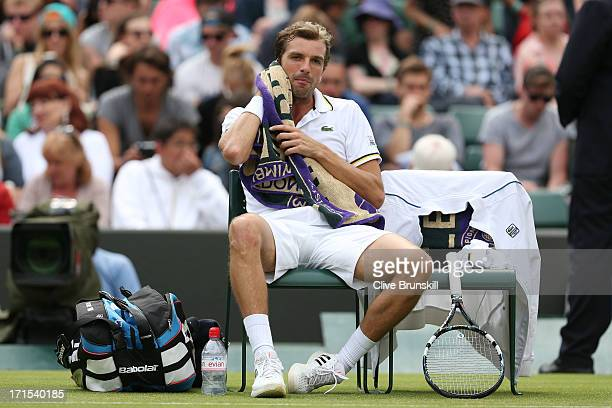 Julien Benneteau of France wipes his face with a towel during a break in his Gentlemen's Singles second round match against Fernando Verdasco of...