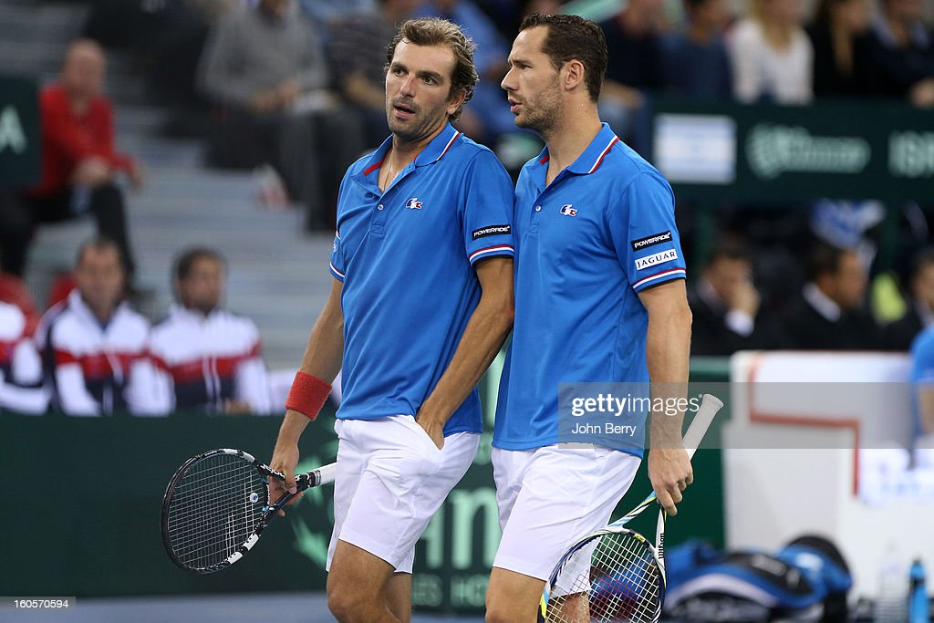 Julien Bennetteau and Michael Llodra of France share tactics during their doubles match against Jonathan Erlich and Dudi Sela of Israel on day two of the Davis Cup first round match between France and Israel at the Kindarena stadium on February 2, 2013 in Rouen, France.