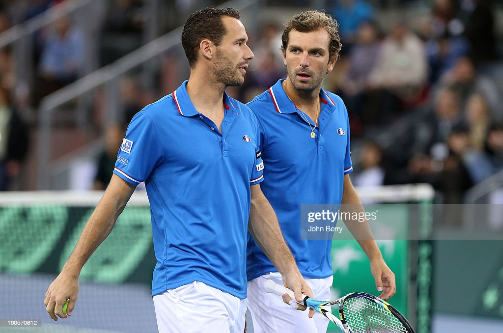 Julien Bennetteau and Michael Llodra (L) of France share tactics during their doubles match against Jonathan Erlich and Dudi Sela of Israel on day two of the Davis Cup first round match between France and Israel at the Kindarena stadium on February 2, 2013 in Rouen, France.