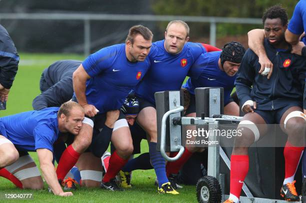 Julien Bonnaire Nicolas Mas and William Servat practice scrummaging during a France IRB Rugby World Cup 2011 training session at Onewa Domain on...