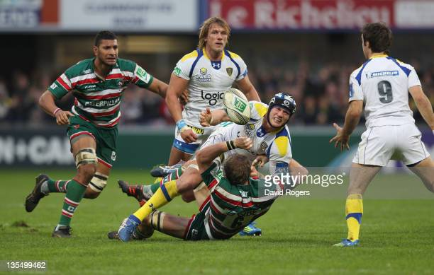 Julien Bonnaire of Clermont Auvergne is tackled by Tom Croft during the Heineken Cup match between ASM Clermont Auvergne and Leicester Tigers at...