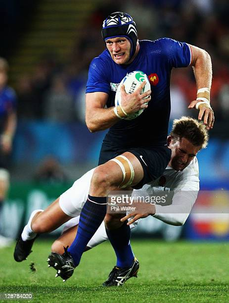 Julien Bonnaire of France is tackled by Toby Flood of England during quarter final two of the 2011 IRB Rugby World Cup between England and France at...