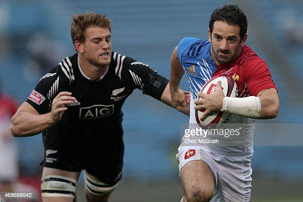 Julien Candelon of France makes a break against New Zealand during the Plate Semifinal match between New Zealand and France on day two of the Tokyo...