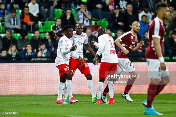 Julien Cetout of Nancy and Issiar Dia of Nancy and Faitout Maouassa of Nancy celebrates scoring his goal during the French Ligue 1 match between Metz...