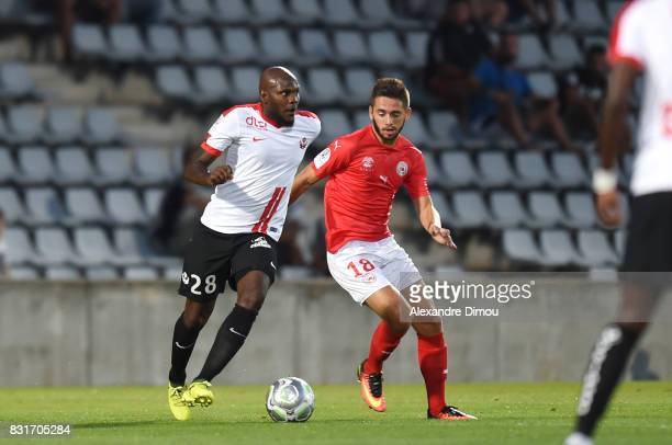 Julien Cetout of Nancy and Theo Valls of Nimes during the Ligue 2 match between Nimes Olympique and As Nancy Lorraine at Stade des Costieres on...