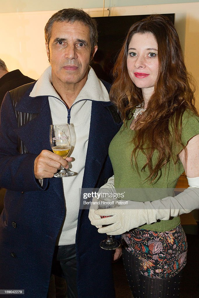 <a gi-track='captionPersonalityLinkClicked' href=/galleries/search?phrase=Julien+Clerc&family=editorial&specificpeople=1018020 ng-click='$event.stopPropagation()'>Julien Clerc</a> (L) and his wife Helene pose after attending the show of French impersonator Laurent Gerra at Olympia hall on January 5, 2013 in Paris, France.