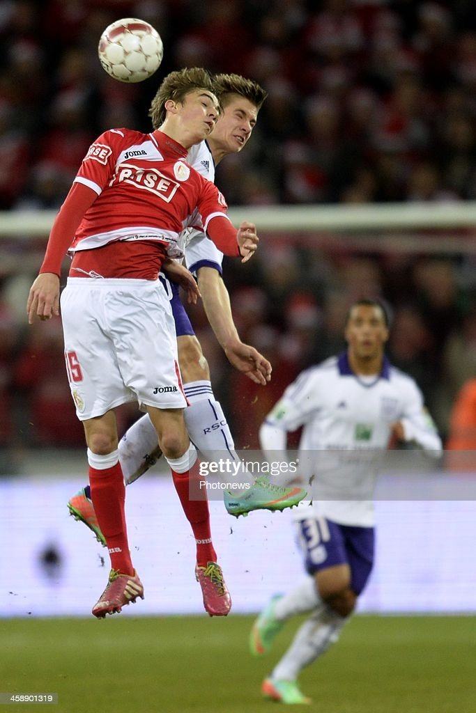 Julien De Sart of Standard battles for the ball with Dennis Praet of RSC Anderlecht during the Jupiler League match between Standard Liege and RSC Anderlecht on December 22, 2013 in Liege, Belgium.