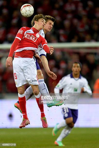 Julien De Sart of Standard battles for the ball with Dennis Praet of RSC Anderlecht during the Jupiler League match between Standard Liege and RSC...