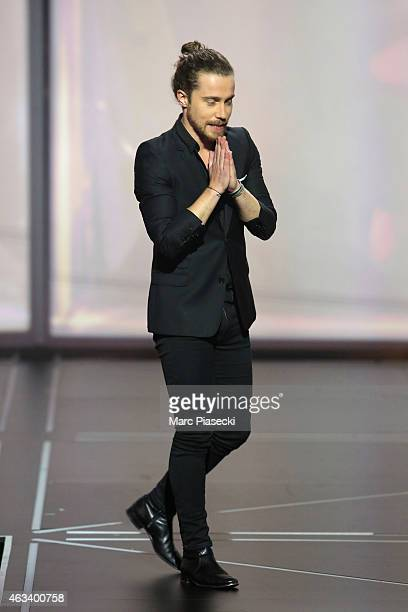 Julien Dore receives the award for the male artist of the year during the 30th 'Victoires de la Musique' French Music Awards Ceremony at le Zenith on...