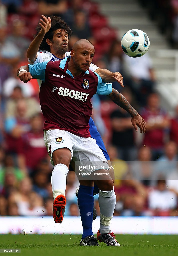 Julien Faubert of West Ham holds off Juan Carlos Valeron of Deportivo during the pre-season friendly match between West Ham United and Deportivo La Coruna at Upton Park on August 7, 2010 in London, England.
